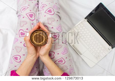 Woman Having A Cup Of Coffee In Bed