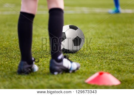 Sport Background. Soccer Football Player with Ball; Boys Playing Soccer Match on Training Field.