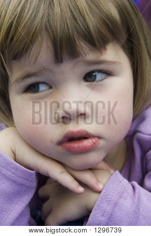 Cute Little Girl Holding Face Up