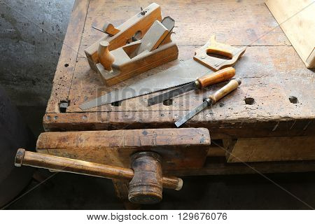 Chisels And A Saw On The Workbench With A Wooden Grip