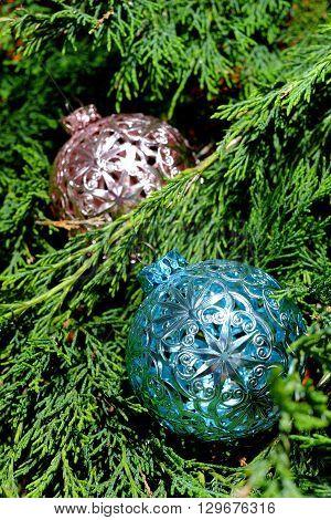 Pink and blue Christmas balls on green pine needles Santa Claus Christmas time
