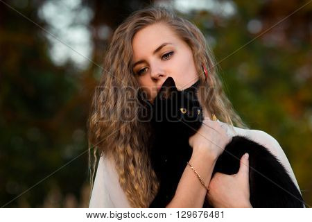 poster of Nice, pretty, lovely, cute, careful, beautiful, attractive blondie, blonde girl, girl with light, wavy, long, curly hair with cat, black cat. Girl with cat. Girl hug cat. Girl love cats. Cat Lady. Love to animals, cat
