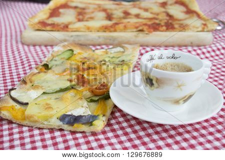 handcraft vegetarian pizza with near a cup of coffee espresso