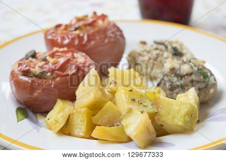 baked chopped potatoes with onions grateed and stuffed mushrooms and tomatoes