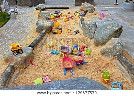 A public artwork functions as a sandbox for children.