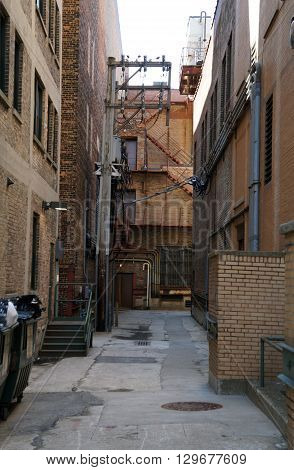 A narrow alleyway between tall buildings in downtown Joliet, Illinois.