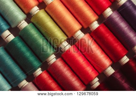 The sewing threads multicolored background close up