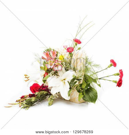 Bouquet from mixed colorful  flowers in basket isolated on white