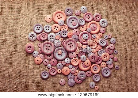 The collection with many buttons of different colors, shape and sizes on canvas with copy space. Top view