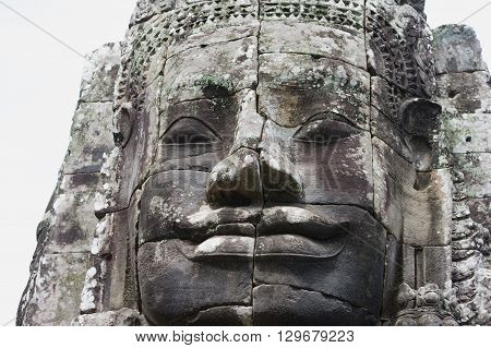 Ancient stone face in Bayon Temple, Angkor Wat complex, Siem Reap, Cambodia. UNESCO World Heritage Site.