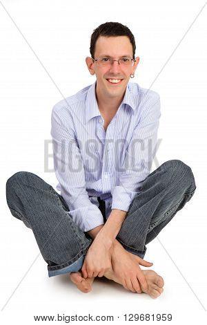 Full portrait of smiling handsome man sitting on the flor
