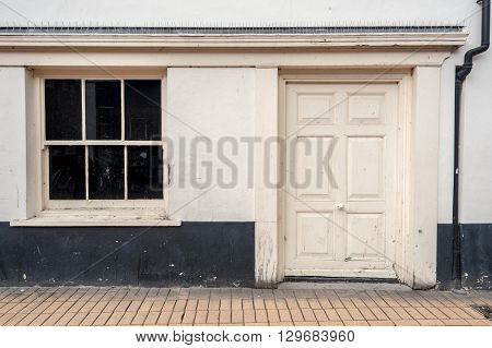 White Painted Wooden Door And Black Window