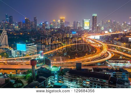 Aerial View Of Bangkok City Downtown Background, Highway Interchanged At Night