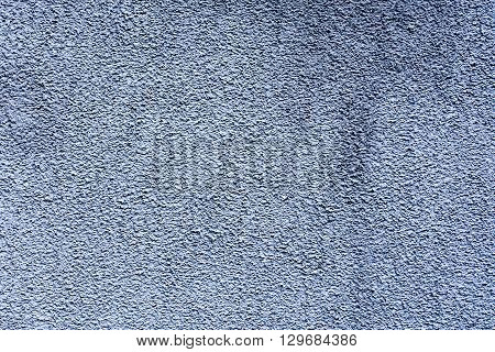rough light grey plaster wall for background or texture