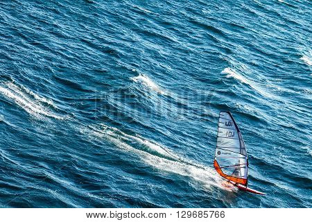 Toulon France - June 27 2009: A windsurf performing in the sea in front of Tthe city.