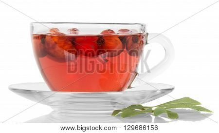 Transparent cup with tea and rose hips isolated on a white background