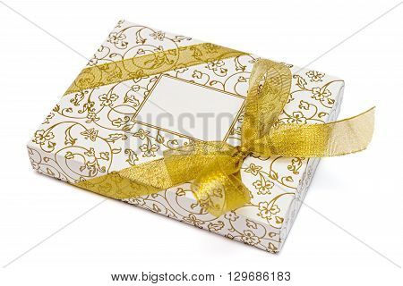 Gift box with gold ribbon and bow isolated on white background