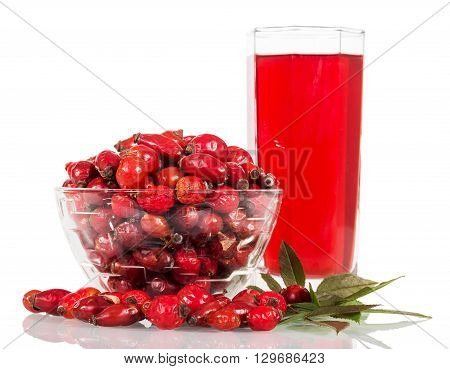 Drink from the hips and a bowl with berries isolated on white background