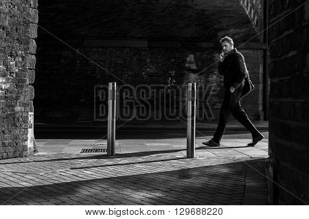 Man Walking Through Sunlight