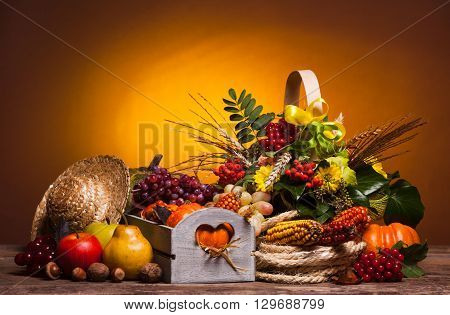 Happy Thanksgiving still life. Fruits, nuts and vegetables, fall crop on  the table