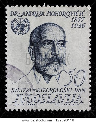 ZAGREB, CROATIA - JUNE 14: Stamp printed in Yugoslavia shows Andrija Mohorovicic Croatian meteorologist and seismologist, circa 1963, on June 14, 2014, Zagreb, Croatia