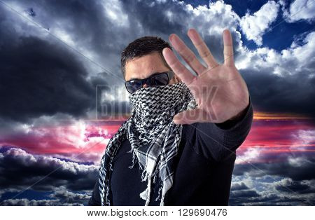 Man Wearing Sunglasses And A Keffiyeh Stop Sign