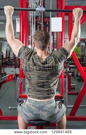 Man Performing Lat Pulldown At The Gym