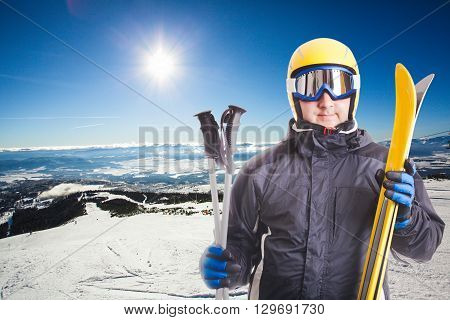 Ski slope in High Tatras mountains on the background and skier portait with equipment