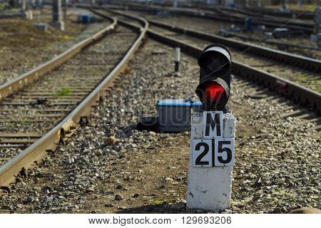 Railway Semaphore Against The Background Tracks And Locomotive