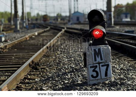 Railway Semaphore Against The Background Tracks And Locomotive