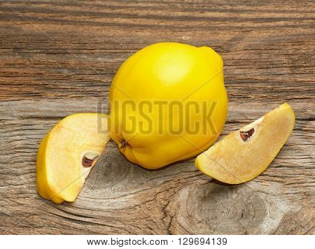 Quince isolated on wooden table in studio