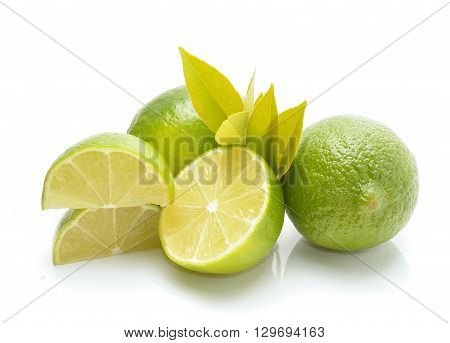Fresh limes isolated on white in studio