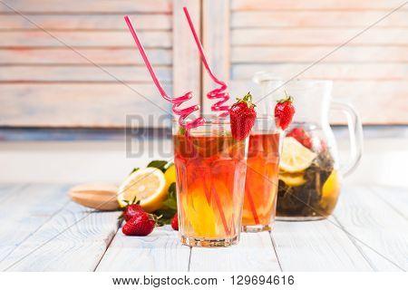 Lemonade with a strawberry, lemon and mint