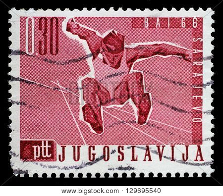ZAGREB, CROATIA - JUNE 14: A stamp printed by Yugoslavia shows Long jump, Balkan Games in Sarajevo, circa 1966, on June 14, 2014, Zagreb, Croatia