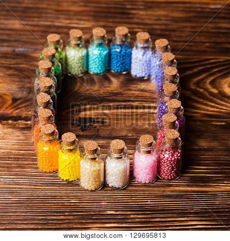 Beads in the vintage mini glass bottles
