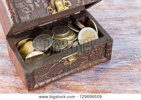 Coins In An Old Wooden Box
