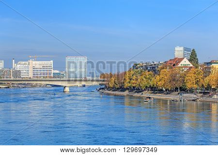 Basel, Switzerland - 31 October, 2014: view along the Rhine river. Basel is a city on the Rhine river in northwestern Switzerland, it is Switzerland's third most populous city after Zurich and Geneva.