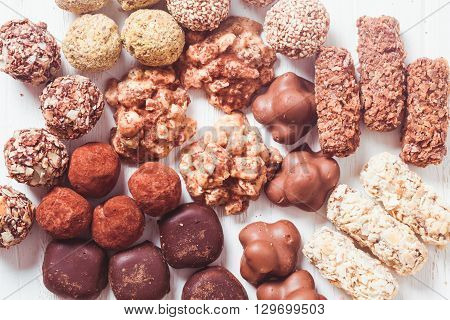 Assorted Chocolate candies on the white table. Luxury handmade sweets