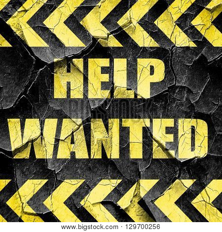 Help wanted sign, black and yellow rough hazard stripes