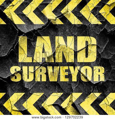 land surveyor, black and yellow rough hazard stripes