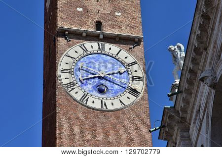 Detail of the Bissa Tower clock, Basilica Palladiana old belfry and the tallest building in the beautiful city of Vicenza