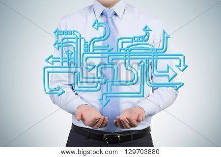Different direction concept with man holding abstract blue arrows in hands
