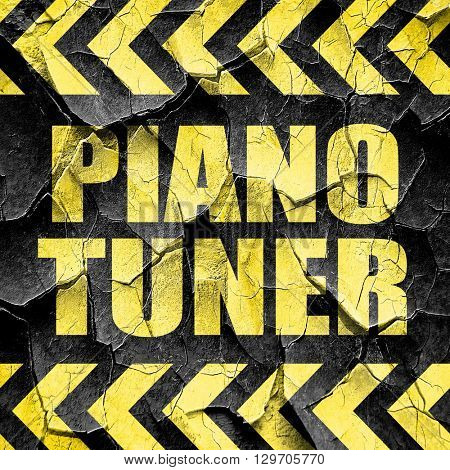 piano tuner, black and yellow rough hazard stripes