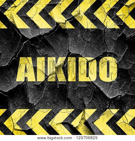 aikido sign background, black and yellow rough hazard stripes