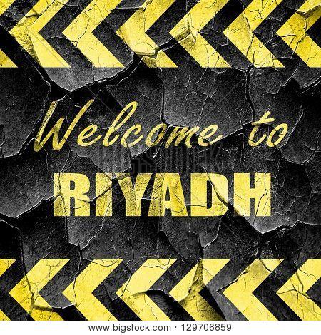 Welcome to riyadh, black and yellow rough hazard stripes