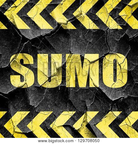 sumo sign background, black and yellow rough hazard stripes