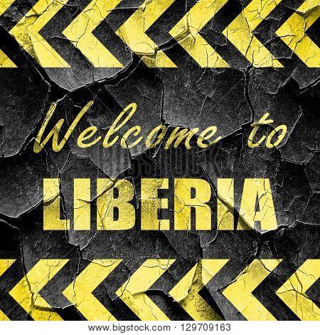 Welcome to liberia, black and yellow rough hazard stripes
