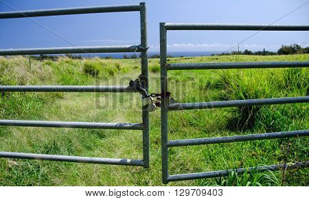 Locked Gates To A Grass Field Along Highway 270 Near Keokea Beach