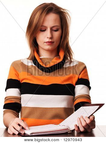 Young Girl Student With Folder Sitting At The Desk