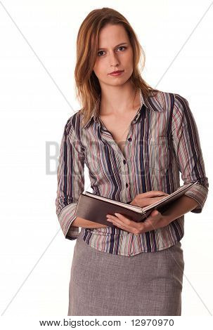 Serious Confident Young Woman Teacher Holds Textbook In Her Hands